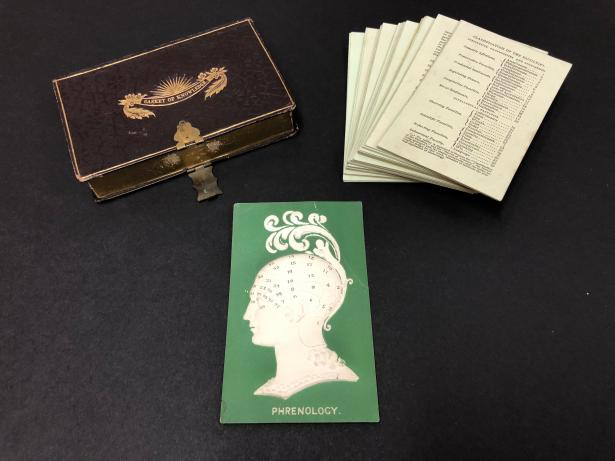 "The ""Casket of Knowledge,"" including a top card with embossed profile of a phrenological head, and corresponding cards. Mrs. L. Miles, Phrenology and the Moral Influence of Phrenology: Arranged on 40 Cards, Illustrative of the System, (London: Ackermann and Co., 1835), History & Special Collections for the Sciences, UCLA Library Special Collections, BF870.P577 1835."