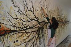 Rohini Devasher working on the mural Parts Unknown (June 2012)