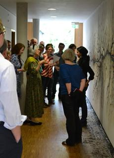 Rohini Devasher with Lorraine Daston and members of Department II (Ideals and Practices of Rationality) in front of the mural Parts Unknown.