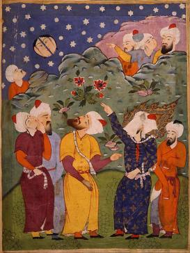 Caption Text: Muhammad inviting his audience to observe the (split) moon  Source: https://en.wikipedia.org/wiki/Splitting_of_the_moon