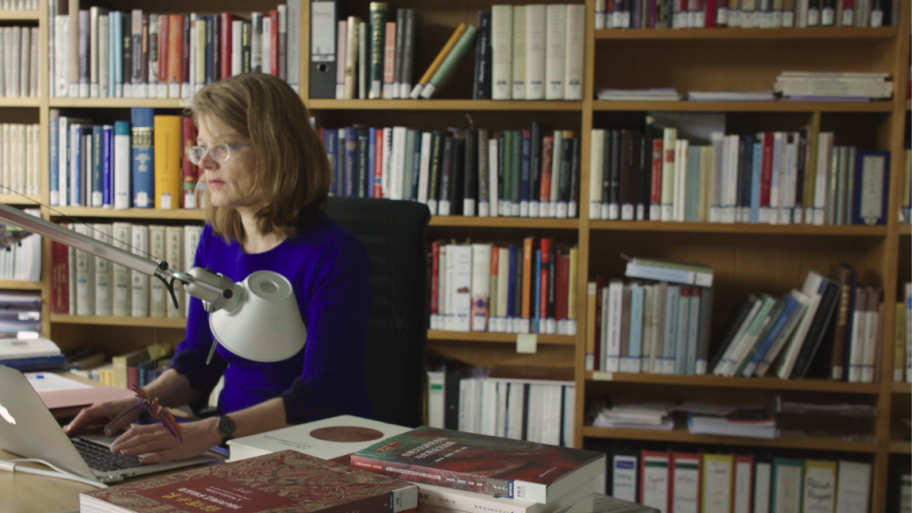 Prof. Dagmar Schäfer working amongst books